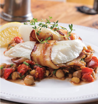 Bacon-Wrapped Haddock over Chickpea Mash